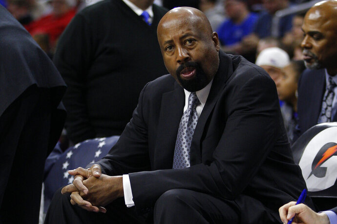 FILE - Los Angeles Clippers' assistant coach Mike Woodson looks on during the second half of an NBA basketball game against the Philadelphia 76ers, Monday, Feb. 8, 2016, in Philadelphia. Woodson, the only Knicks coach to win a playoff series in the last two decades and the last one to even reach the postseason, is coming back to New York as an assistant on Tom Thibodeau's staff. Woodson was one of the assistant coaches announced Friday, Sept. 4, 2020, by the Knicks, who hired Thibodeau as their coach last month. (AP Photo/Chris Szagola, File)