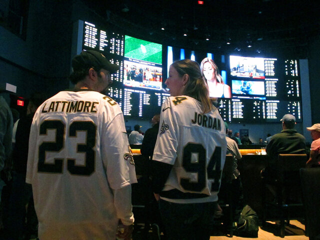 This Sept. 9, 2018 photo shows football fans waiting for kickoff in the sports betting lounge at the Ocean Casino Resort in Atlantic City, N.J. Figures released on Thursday, Oct. 15, 2020 showed New Jersey broke its own recently set U.S. record for the most money bet on sports in a single month in September when gamblers plunked down more than $748 million on sports. (AP Photo/Wayne Parry)