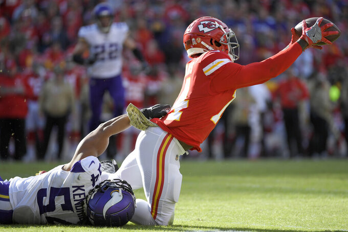 Kansas City Chiefs wide receiver Sammy Watkins (14) makes a catch against Minnesota Vikings linebacker Eric Kendricks (54) during the second half of an NFL football game in Kansas City, Mo., Sunday, Nov. 3, 2019. (AP Photo/Reed Hoffmann)