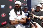 San Francisco 49ers cornerback Richard Sherman talks to reporters after a combined NFL football training camp with the Denver Broncos at the Broncos' headquarters Friday, Aug. 16, 2019, in Englewood, Colo. (AP Photo/David Zalubowski)