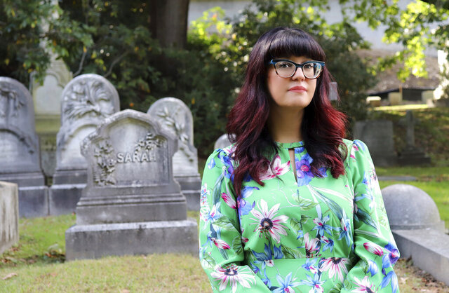 Sarah Chavez poses for a portrait on the grounds of Boston's historic Mount Auburn Cemetery during Death Salon, an event series hosted by The Order of the Good Death, in 2018. Instead of having her body buried or cremated, Chavez said she would opt to have her human remains turned into soil. Death is a natural process, and to Chavez, this would be not only environmentally friendly but also an act of resistance. (Bruno Huerta/RNS via AP)
