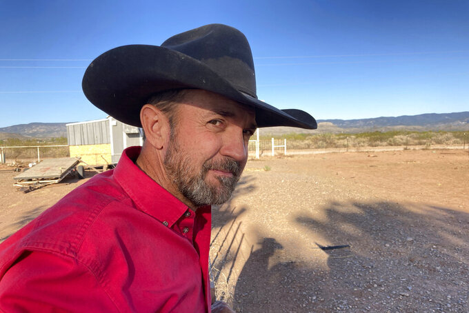 FILE - In this May 12, 2021, file photo, Otero County Commissioner Couy Griffin, the founder of Cowboys for Trump, takes in the view from his ranch in Tularosa, N.M. Time is running out for a petition drive to recall Cowboys for Trump founder Couy Griffin from office as a county commissioner in southern New Mexico. Backers of the petition drive in Otero County say they still need to collect several hundred additional signatures by next Wednesday to trigger a special recall election against Griffin. (AP Photo/Morgan Lee, File)