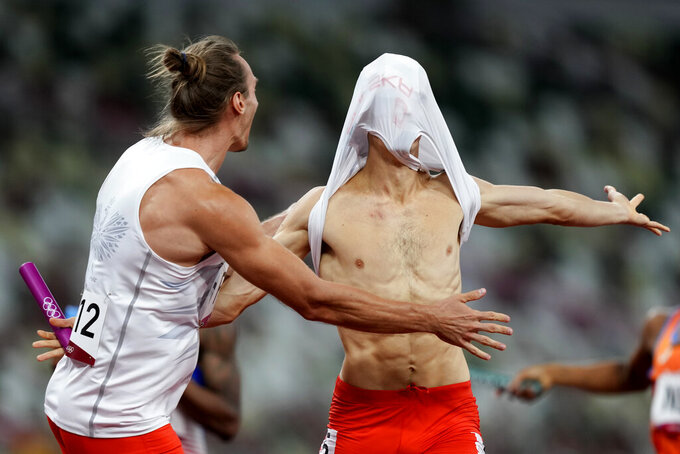 The team from Poland celebrates after winning winning the 4 x 400-meter mixed relay final at the 2020 Summer Olympics, Saturday, July 31, 2021, in Tokyo. (AP Photo/Martin Meissner)