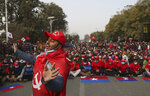 A Nepalese supporter of the splinter group in the governing Nepal Communist Party dances as other participate in a protest in Kathmandu, Nepal, Friday, Jan. 22, 2021. Thousands of demonstrators rallied in Nepal's capital Friday protesting against the prime minister who had dissolved the parliament and ordered fresh election because of feuds within the ruling political party. (AP Photo/Niranjan Shrestha)