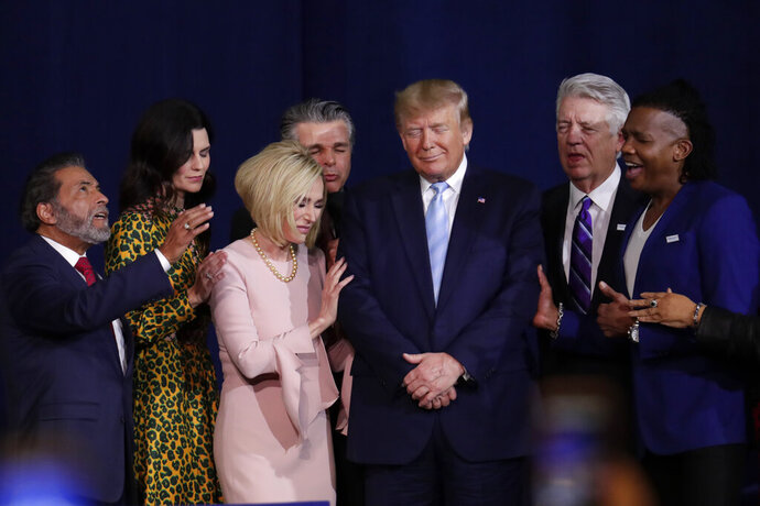 Faith leaders pray with President Donald Trump during a rally for evangelical supporters at the King Jesus International Ministry church, Friday, Jan. 3, 2020, in Miami. (AP Photo/Lynne Sladky)