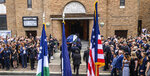 An honor guard carries the body of retired New York Police Department Detective Luis Alvarez into the Immaculate Conception Roman Catholic church in the Queens borough of New York for his funeral service on Wednesday, July, 3, 2019. Alvarez died Saturday, June 29, 2019 after a three-year battle with colorectal cancer. He attributed his illness to the three months he spent digging through rubble at the World Trade Center's twin towers after the 2001 terrorist attacks. (J. Conrad Williams Jr./Newsday via AP)