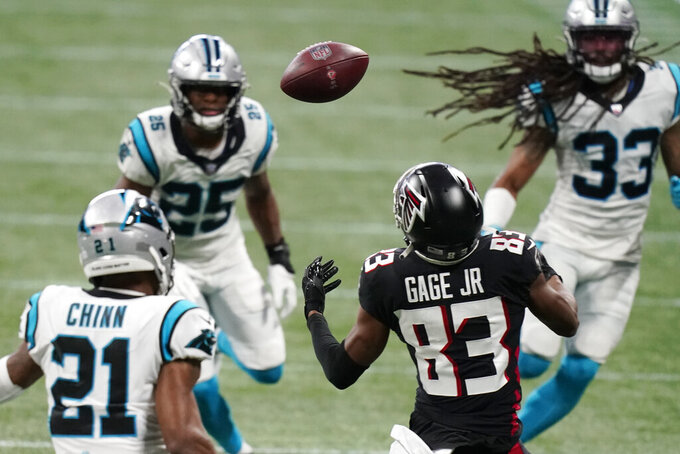 Atlanta Falcons wide receiver Russell Gage (83) misses the catch against Carolina Panthers outside linebacker Jeremy Chinn (21) during the first half of an NFL football game, Sunday, Oct. 11, 2020, in Atlanta. (AP Photo/Brynn Anderson)