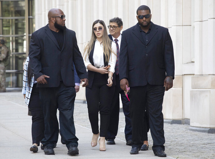 FILE- In this July 17, 2019 file photo, New York City police officer Ishmael Bailey, right, moonlights as a bodyguard for Emma Coronel Aispuro, wife of Mexican drug lord Joaquin