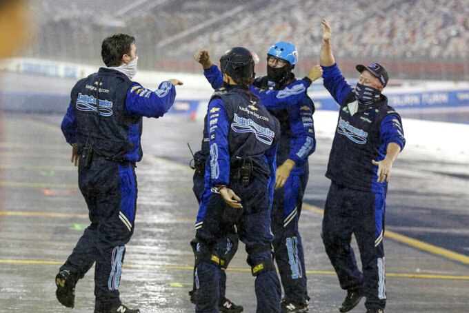 The pit crew of the Ellsworth Advisors Chevrolet celebrate as AJ Allmendinger wins a NASCAR Xfinity Series auto race at Charlotte Motor Speedway in Concord, N.C., Saturday, Oct. 10, 2020. (AP Photo/Nell Redmond)