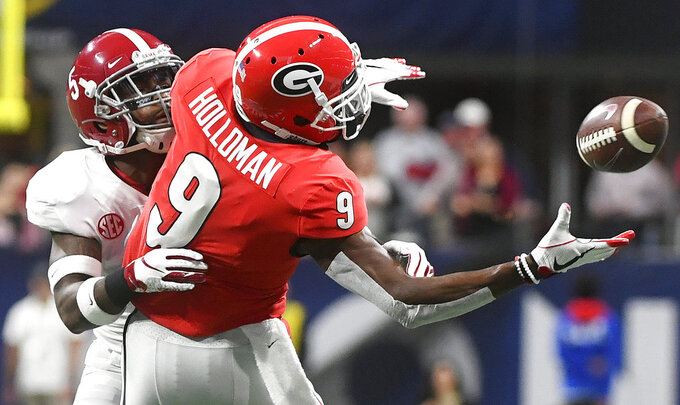 Georgia wide receiver Jeremiah Holloman (9) misses the catch against Alabama defensive back Shyheim Carter (5) during the first half of the Southeastern Conference championship NCAA college football game, Saturday, Dec. 1, 2018, in Atlanta. (AP Photo/John Amis)