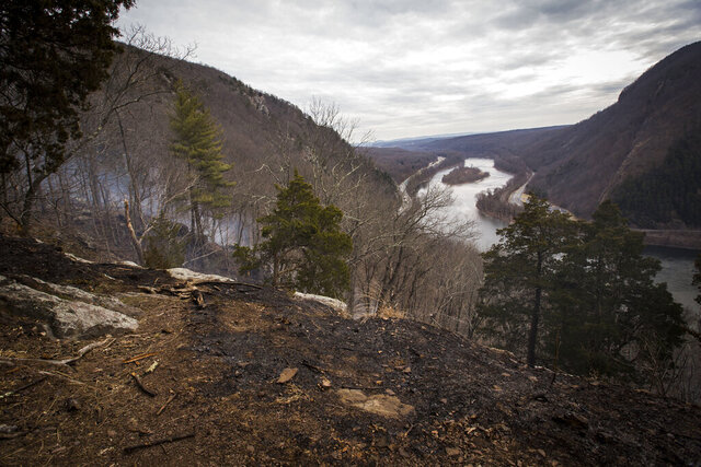 Scorched ground is seen along Mount Tammany's Red Dot Loop Trail following a wildfire that began Sunday and spread throughout the area into Monday, Feb. 24, 2020, in the Delaware Water Gap National Recreation Area in Hardwick, N.J. (Daniel Freel/New Jersey Herald via AP)