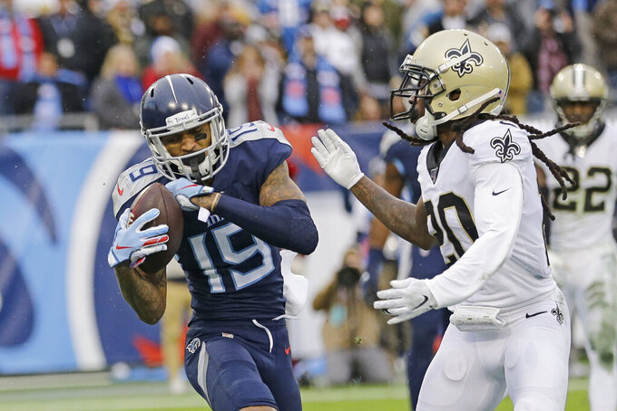 Tennessee Titans wide receiver Tajae Sharpe (19) catches a 7-yard touchdown pass against New Orleans Saints cornerback Janoris Jenkins (20) in the second half of an NFL football game Sunday, Dec. 22, 2019, in Nashville, Tenn. (AP Photo/James Kenney)