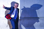 British Conservative party leadership contender Michael Gove gestures as he leaves BBC House after a TV debate in central London Tuesday, June 18, 2019. (AP Photo/Vudi Xhymshiti)