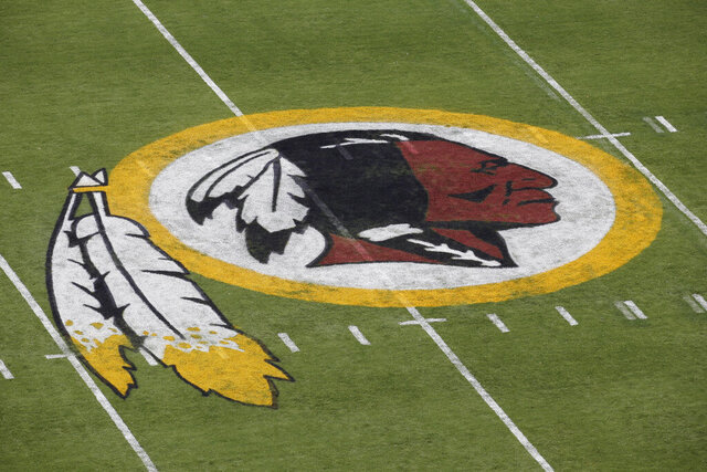 FILE - In this Aug. 7, 2014 file photo, the Washington Redskins NFL football team logo is seen on the field before an NFL football preseason game against the New England Patriots in Landover, Md. The recent national conversation about racism has renewed calls for the Washington Redskins to change their name. D.C. mayor Muriel Bowser called the name an