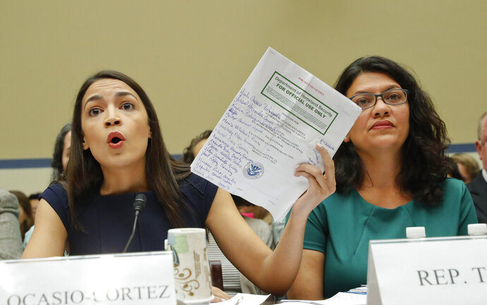 Rep. Alexandria Ocasio-Cortez, D-NY., left, testifies before the House Oversight Committee hearing on family separation and detention centers, Friday, July 12, 2019 on Capitol Hill in Washington. Also on the panel is Rep. Rashida Tlaib, D-Mich. (AP Photo/Pablo Martinez Monsivais)