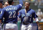 Seattle Mariners' Tim Beckham, right, celebrates after scoring against the Oakland Athletics in the second inning of a baseball game Wednesday, July 17, 2019, in Oakland, Calif. (AP Photo/Ben Margot)