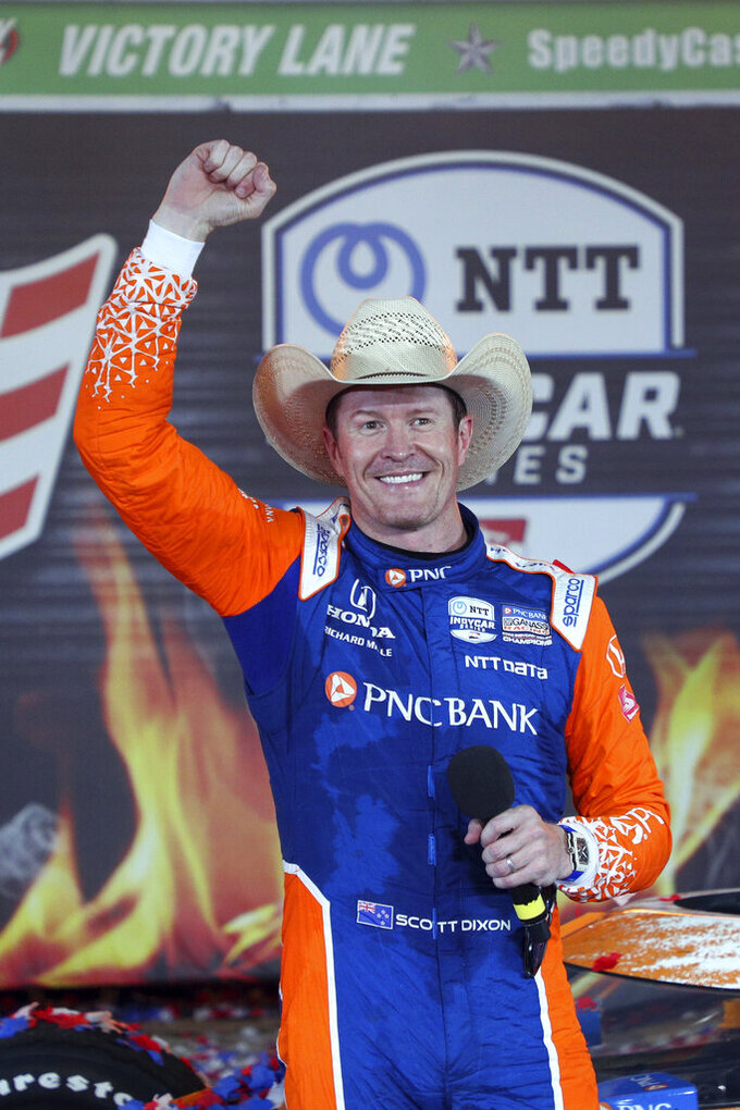 Scott Dixon pumps his fist after winning the IndyCar Series auto race at Texas Motor Speedway on Saturday, May 1, 2021, in Fort Worth, Texas. (AP Photo/Richard W. Rodriguez)