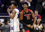Rutgers forward/center Myles Johnson, right, reacts after scoring a basket as Northwestern guard Anthony Gaines reacts during the second half of an NCAA college basketball game, Wednesday, Feb. 13, 2019, in Evanston, Ill. Rutgers won 59-56. (AP Photo/Nam Y. Huh)
