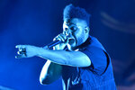 FILE - The Weeknd performs on day three at Lollapalooza in Chicago on Aug 4, 2018.  The Weeknd was nominated for eight American Music Awards on Monday. The 2020 American Music Awards will air live on Nov. 22 on ABC. (Photo by Rob Grabowski/Invision/AP, File)