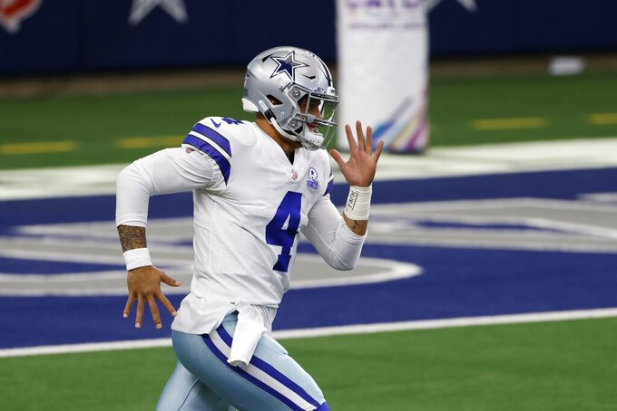 Dallas Cowboys quarterback Dak Prescott (4) jogs onto the field for warmups before an NFL football game against the Cleveland Browns in Arlington, Texas, Sunday, Oct. 4, 2020. (AP Photo/Ron Jenkins)