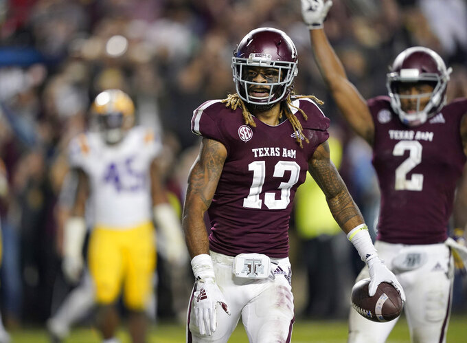 Texas A&M wide receiver Kendrick Rogers (13) reacts after catching a pass for a two-point conversion during the seventh overtime of an NCAA college football game against LSU Saturday, Nov. 24, 2018, in College Station, Texas. Texas A&M won 74-72. (AP Photo/David J. Phillip)