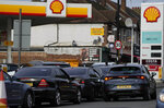 Drivers queue for fuel at a petrol station in London, Tuesday, Sept. 28, 2021. Long lines of vehicles have formed at many gas stations around Britain since Friday, causing spillover traffic jams on busy roads. (AP Photo/Frank Augstein)