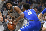 Georgetown guard Jagan Mosely (4) and Creighton guard Ty-Shon Alexander (5) battle for the ball during the second half of an NCAA college basketball game, Wednesday, Jan. 15, 2020, in Washington. Georgetown won 83-80. (AP Photo/Nick Wass)