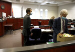 Mark Gooch, left, watches as his attorney, Bruce Griffen, gathers materials in Coconino County Superior Court in Flagstaff, Ariz., on Friday, Oct. 8, 2021. Gooch, a U.S. Air Force airman, is accused of kidnapping and killing Sasha Krause, a Mennonite woman who lived in northwestern New Mexico and whose body was found on the outskirts of Flagstaff.(Jake Bacon/Arizona Daily Sun via AP)