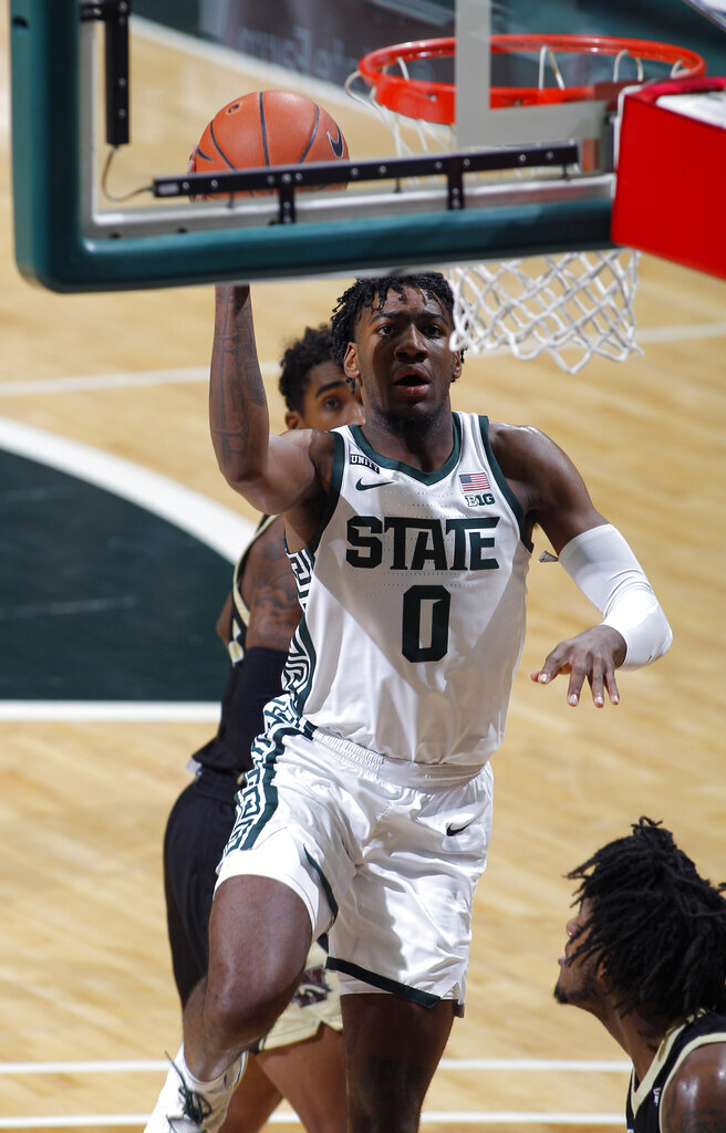 Michigan State's Aaron Henry goes up for a layup against Western Michigan during the first half of an NCAA college basketball game, Sunday, Dec. 6, 2020, in East Lansing, Mich. (AP Photo/Al Goldis)