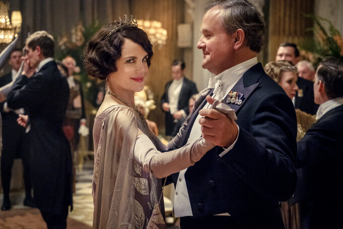 "This image released by Focus Features shows Elizabeth McGovern, left, as Lady Grantham and Hugh Bonneville, as Lord Grantham, in ""Downton Abbey"". The original principal cast of ""Downton Abbey"" are returning for a second film that will arrive in theaters December 22 this year, Focus Features announced Monday. ""Downton Abbey"" creator Julian Fellowes has written the screenplay, and Simon Curtis is directing. (Jaap Buitendijk/Focus Features via AP)"