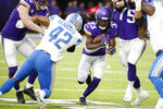 Minnesota Vikings running back Dalvin Cook (33) runs from Detroit Lions outside linebacker Devon Kennard (42) during the first half of an NFL football game, Sunday, Dec. 8, 2019, in Minneapolis. (AP Photo/Bruce Kluckhohn)