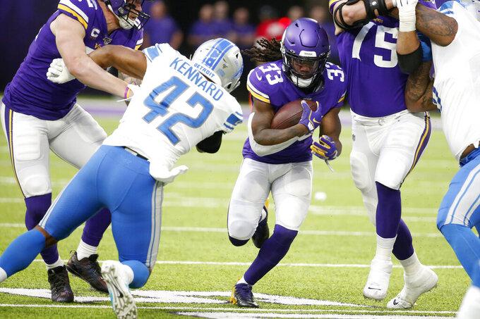 Minnesota Vikings running back Dalvin Cook (33) runs from Detroit Lions outside linebacker Devon Kennard (42) during the first half of an NFL football game, Sunday, Dec. 8, 2019, in Minneapolis. (AP Photo/Bruce Kluckhohn)