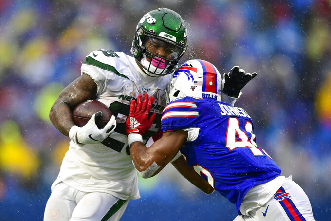 Buffalo Bills linebacker Maurice Alexander (41) tackles New York Jets running back Le'Veon Bell (26) during the first half of an NFL football game Sunday, Dec. 29, 2019 in Orchard Park, N.Y. (AP Photo/David Dermer)