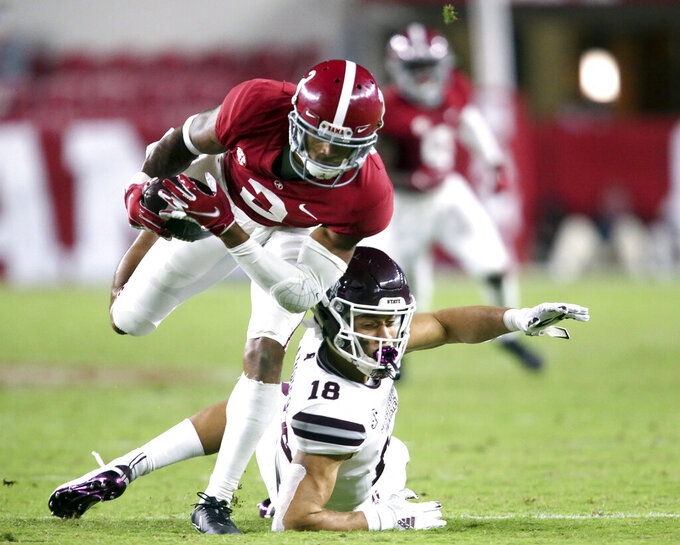 FILE - Alabama defensive back Patrick Surtain II (2) makes an interception that he returned for a touchdown against Mississippi State during the second half of an NCAA college football game in Tuscaloosa, Ala., in this Saturday, Oct. 31, 2020, file photo. Surtain used Alabama's first pro day on Tuesday, March 23, 2021, to show he deserves to be considered at the top of a very competitive class of draft picks. Surtain, rated as the top cornerback in the draft, posted unofficial times of 4.42 and 4.44 seconds in the 40-yard dash before NFL scouts and coaches at Alabama's indoor practice facility. (Gary Cosby Jr.//The Tuscaloosa News via AP, File)