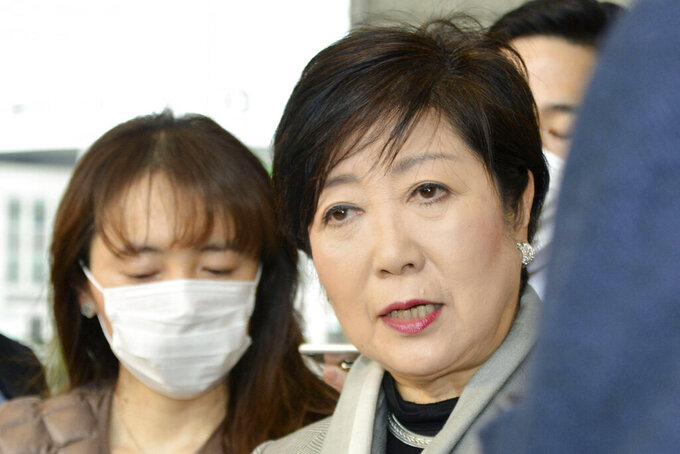 Tokyo Gov. Yuriko Koike, right, answers a reporter's question about the latest policy of International Olympic Committee, at Tokyo Metropolitan Government in Tokyo Monday, March 23, 2020. The IOC will take four weeks to weigh options for the Tokyo Games amid mounting calls from athletes and Olympic officials for a postponement due to the coronavirus pandemic. (Kyodo News via AP)