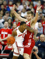 Ohio State guard Luther Muhammad, left, drives in front of Wisconsin guard Brad Davidson during the first half of an NCAA college basketball game in Columbus, Ohio, Friday, Jan. 3, 2020. (AP Photo/Paul Vernon)