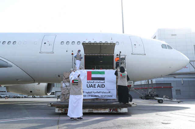 In this Tuesday, May 19, 2020 photo released by the state-run WAM news agency, an Etihad Airways flights loaded with aid for the Palestinians to fight the coronavirus pandemic is loaded in Abu Dhabi, United Arab Emirates. Etihad Airways flew aid for the Palestinians amid the coronavirus pandemic from the capital of the United Arab Emirates into Israel on Tuesday, marking the first known direct commercial flight between the two nations. (WAM via AP)