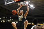 Purdue forward Evan Boudreaux dunks the ball during the first half of an NCAA college basketball game against Iowa, Tuesday, March 3, 2020, in Iowa City, Iowa. (AP Photo/Charlie Neibergall)