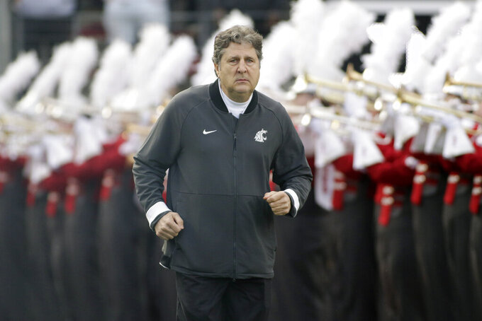 FILE - In this Nov. 16, 2019, file photo, Washington State head coach Mike Leach runs onto the field before an NCAA college football game against Stanford, in Pullman, Wash. Two people with knowledge of the decision says Mississippi State has hired Washington State's Mike Leach as its new head coach.  The people spoke to The Associated Press on condition of anonymity Thursday, Jan. 9, 2020, because the school has not yet officially announced the move. Leach will replace Joe Moorhead, who was fired last week after two seasons. (AP Photo/Young Kwak, File)