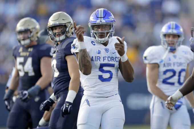 Air Force quarterback Donald Hammond III gestures after rushing for a first down against Navy during the first half of an NCAA college football game Saturday, Oct. 5, 2019, in Annapolis, Md. (AP Photo/Julio Cortez)