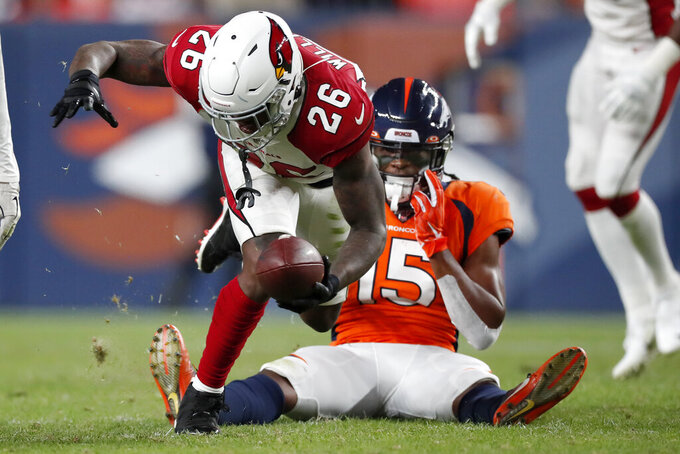 Arizona Cardinals cornerback Brandon Williams (26) intercepts a pass intended for Denver Broncos wide receiver Juwann Winfree (15) during the second half of an NFL preseason football game, Thursday, Aug. 29, 2019, in Denver. (AP Photo/David Zalubowski)