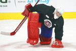 Montreal Canadiens goaltender Carey Price stretches during an NHL hockey practice in Brossard, Quebec, Tuesday, Jan. 5, 2021. (Paul Chiasson/The Canadian Press via AP)
