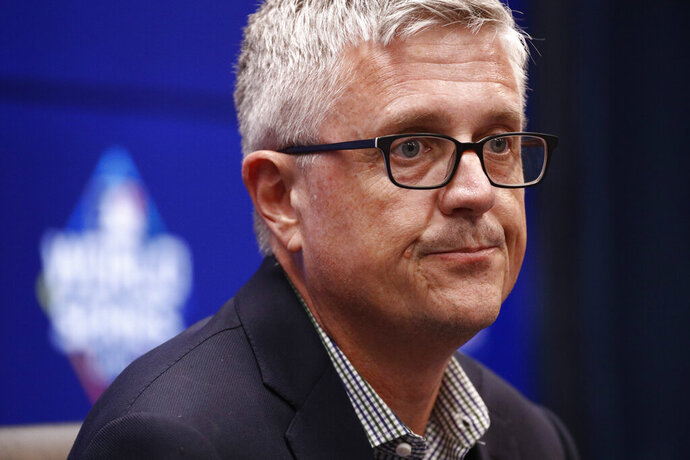 FILE - In this Oct. 24, 2019, file photo, Houston Astros general manager Jeff Luhnow speaks at a baseball World Series news conference in Washington. Houston  manager AJ Hinch and general manager Jeff Luhnow were suspended for the entire season Monday, Jan. 13, 2020,  and the team was fined $5 million for sign-stealing by the team in 2017 and 2018 season. Commissioner Rob Manfred announced the discipline and strongly hinted that current Boston manager Alex Cora — the Astros bench coach in 2017 — will face punishment later. Manfred said Cora developed the sign-stealing system used by the Astros. (AP Photo/Patrick Semansky, File)