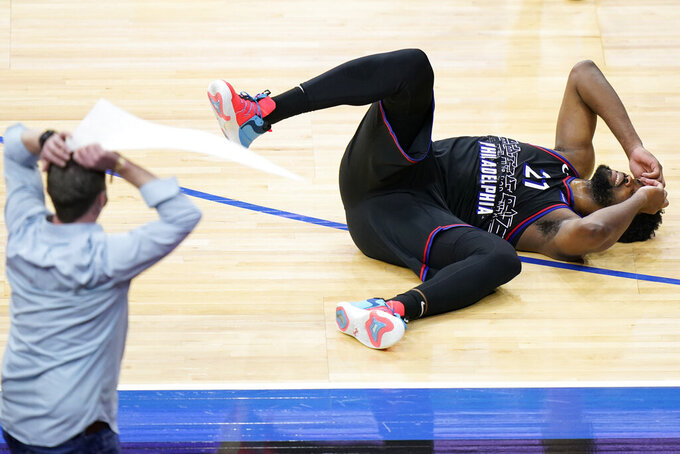 Philadelphia 76ers' Joel Embiid, right, reacts after missing a shot in the final second of an NBA basketball game against the Phoenix Suns, Wednesday, April 21, 2021, in Philadelphia. (AP Photo/Matt Slocum)