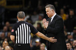 Purdue head coach Matt Painter questions a call against his team during the first half of an NCAA college basketball game against Iowa, Tuesday, March 3, 2020, in Iowa City, Iowa. (AP Photo/Charlie Neibergall)