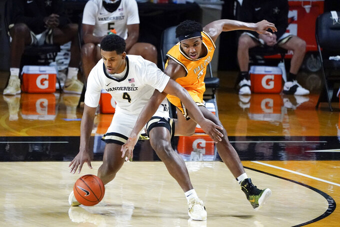 Vanderbilt guard Jordan Wright (4) protects the ball from Valparaiso guard Donovan Clay, right, in the first half of an NCAA college basketball game Friday, Nov. 27, 2020, in Nashville, Tenn. (AP Photo/Mark Humphrey)