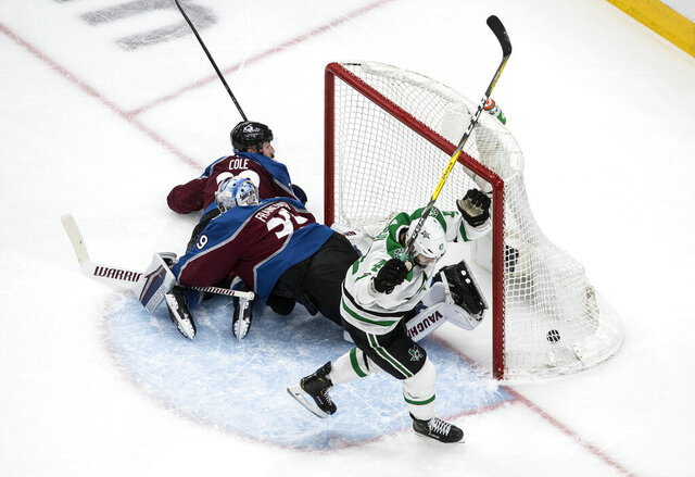 Dallas Stars' Alexander Radulov (47) celebrates his goal against Colorado Avalanche goalie Pavel Francouz as Avalanche's Ian Cole (28) looks on during second-period NHL Western Conference Stanley Cup playoff hockey game action in Edmonton, Alberta, Saturday, Aug. 22, 2020. (Jason Franson/The Canadian Press via AP)