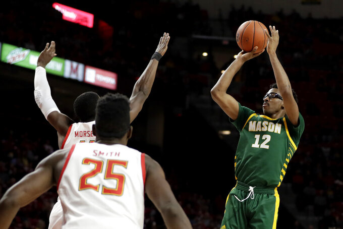 George Mason forward AJ Wilson (12) shoots a basket during the first half of the team's NCAA college basketball game against Maryland on Friday, Nov. 22, 2019, in College Park, Md. (AP Photo/Julio Cortez)