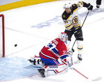 Boston Bruins right wing David Pastrnak (88) scores his third goal of the game past Montreal Canadiens goaltender Keith Kinkaid (37) during second period NHL hockey action Tuesday, Nov. 26, 2019 in Montreal. (Ryan Remiorz/The Canadian Press via AP)