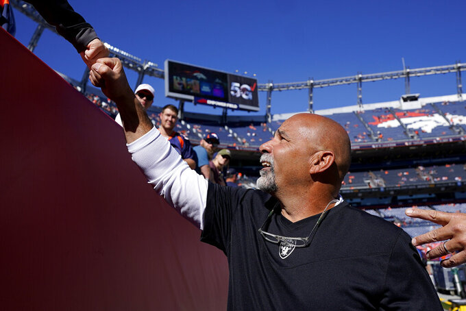 Las Vegas Raiders interim head coach Rich Bisaccia greets fans prior to an NFL football game against the Denver Broncos, Sunday, Oct. 17, 2021, in Denver. (AP Photo/Jack Dempsey)